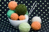 A lot of bright balls for knitting on a dark background — Stock Photo