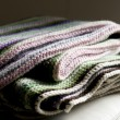 Knitting striped rug with white, purple, green and pink stripes — Stock Photo #68257455