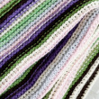 Knitting striped rug with white, purple, green and pink stripes — Stock Photo #68257457