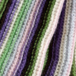 Knitting striped rug with white, purple, green and pink stripes — Stock Photo #68257465