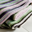 Knitting striped rug with white, purple, green and pink stripes — Stock Photo #68260625