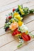 Bouquet of colorful spring flowers lying on the unpainted wooden — Stock Photo