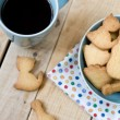 Sweet tasty cookies in the blue plate and cup of black coffee — Stock Photo #72244417