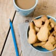 Sweet tasty cookies in the blue plate, a cup of coffee with milk — Stock Photo #72244457