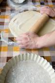 Sooking and home concept - close up of male hands kneading dough — Stock Photo