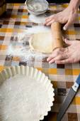 Cooking and home concept - close up of male hands kneading dough — Stock Photo