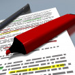 Red pen marker and blue pen on an highlighted document — Stock Photo #71362739