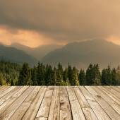 Wood terrace and perspective view on forest mountains — Stock Photo
