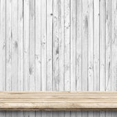 Wood table and white wooden wall  — Stockfoto