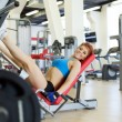 Cheerful young sportswoman exercising in gym — Stock Photo #51819941