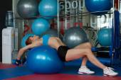 Woman doing stretching exercises on gymnastic ball — Stock Photo