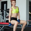 Attractive red-haired female athlete posing in gym — Foto Stock