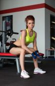 Beautiful young woman posing in fitness center — Stock Photo