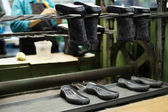 Footwear production - boots and rubber soles — Stock Photo
