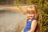 Portrait of little blond girl on vacation in park — Stock Photo