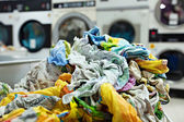 Pile of dirty laundry in laundrette — Stock Photo