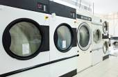 Close-up on rotating drums of washing machines — Stock Photo