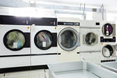 Image of working washing machines in laundry room — Stock Photo