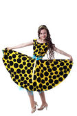 Curly-haired fashionista posing in polka dot dress — Stock Photo