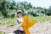 Smiling little girl playing with windmill — Stock Photo