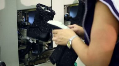Working woman checks workpiece boots, close-up — Stock Video