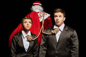 Tense business people tied to Santa Claus — ストック写真