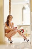Sexy bride in lingerie posing with glass of wine — Foto de Stock