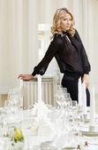 Elegant blonde posing in posh restaurant — Stock Photo