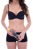 Harmonous girl posing with bottle of water — Stock Photo