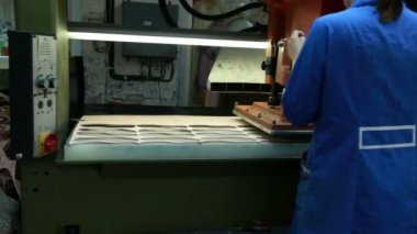 View of worker woman making insoles using press — Stock Video