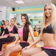 Beautiful athletic girls posing in fitness gym — Stock Photo #70230567