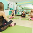 Image of pretty girls practicing yoga in gym — Stock Photo #70866327