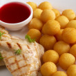 Grilled meat, cheese balls and cranberry sauce — Stock Photo #71743481