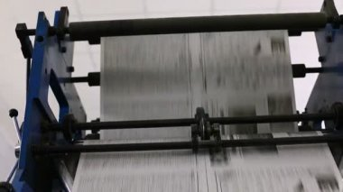 Pan on black and white newspaper line — Stockvideo