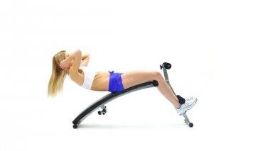 Athletic young woman on exerciser — Vídeo stock