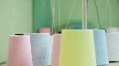 Colorful spools of thread background — Stock Video
