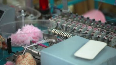 Girl working for machine by hand-knitting — Stock Video