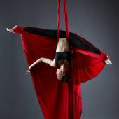 Graceful dancer on aerial silks posing upside down — Stock Photo