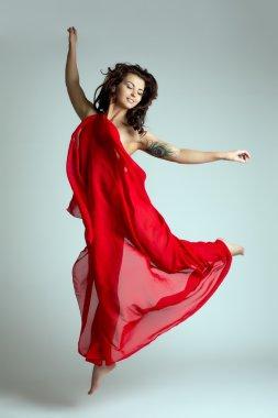 Graceful female dancer posing in jump