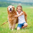 Little girl with golden retriever — Stock Photo #54580621