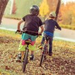 Boys riding bikes — Stock Photo #57683515