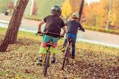 Boys riding bikes — Stock Photo