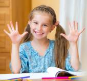 Schoolgirl Studying In Classroom — Stock Photo