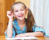 Cute little girl studying — Stock Photo