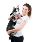 Happy young girl and dog Husky — Stock Photo
