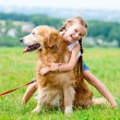 Little girl with golden retriever — Stock Photo #59320399