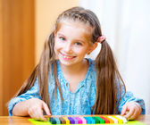 Little girl playing with plasticine — Stock Photo