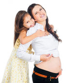 Little girl and her pregnant mother — Stock Photo
