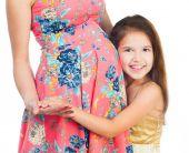 Little girl hugging belly — Stock Photo
