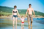Beautiful family on the beach — Стоковое фото